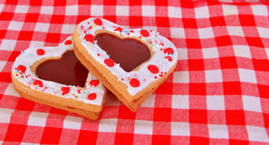 Heart cookies on the red table cloth Stock Photography