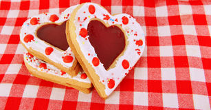 Heart cookies on the red table cloth Royalty Free Stock Photo