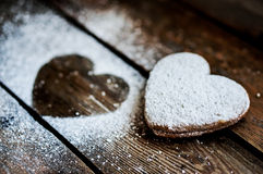 Heart cookies with sugar powder on rustic wooden background Stock Photos