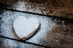 Heart cookies with sugar powder on rustic wooden background Royalty Free Stock Photos