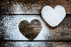 Heart cookies with sugar powder on rustic wooden background Royalty Free Stock Photography