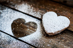 Heart cookies with sugar powder on rustic wooden background Stock Photography