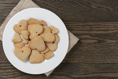 Heart cookies for valentines day in plate on wood Stock Image
