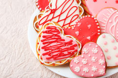 Heart cookies on white plate on the pink paper background Stock Photography