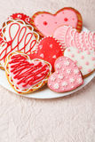 Heart cookies on white plate on a pink paper background Stock Image