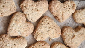 Heart cookies on a wooden brown background, Valentines Day idea stock video footage