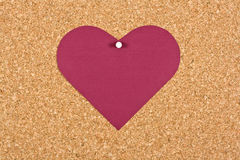 Heart on corkboard Stock Photo