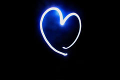 Heart creat by torch on Black background. Heart picture/symbol created by torch on Black background Stock Photo