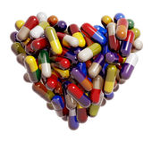 Heart created of colorful medical pills Royalty Free Stock Image