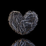 Heart Created Out Of Nails (Reflection On Black). Heart Created Out Of Nails (Reflection On Black Background royalty free illustration
