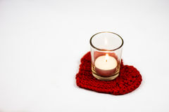 Heart crochet coaster and candle Royalty Free Stock Photos
