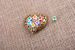 Heart cubes on Heart shaped object Royalty Free Stock Photos