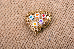 Heart cubes on Heart shaped object Royalty Free Stock Photo
