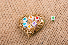 Heart cubes on Heart shaped object Stock Photo