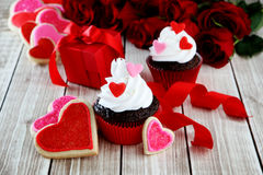 Heart cupcakes. On wood background with decorations Royalty Free Stock Photo