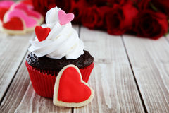 Heart cupcakes. On wood background with decorations Royalty Free Stock Images