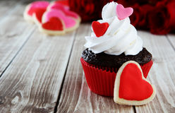 Heart cupcakes. On wood background with decorations Stock Photography