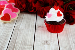 Heart cupcakes. On wood background with decorations Royalty Free Stock Photography