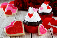 Heart cupcakes. On wood background with decorations Stock Image