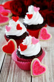 Heart cupcakes. On wood background with decorations Royalty Free Stock Photos