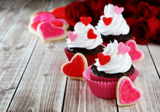 Heart cupcakes. On wood background with decorations Stock Photo