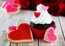 Heart cupcakes. On wood background with decorations Stock Images
