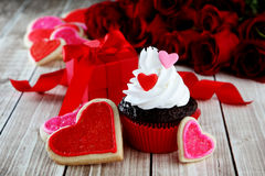 Heart cupcakes. On wood background with decorations Stock Photos