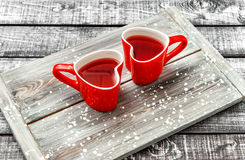 Heart cups red drink rustic wooden background Stock Photos