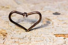 Heart of curved nails, a symbol of overcoming difficulties on th. E way to happiness stock images