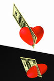 The heart cut by a banknote Stock Photo