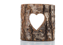 Heart cut in hollow tree trunk. On white background Royalty Free Stock Photography