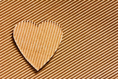 Heart cut out of cardboard Stock Images