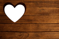 Heart cut out in wood Stock Images