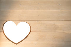 Heart cut out in wood Stock Photography