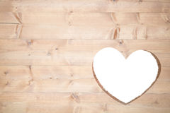 Heart cut out in wood Stock Photos