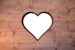 Heart cut out in wood Royalty Free Stock Photo
