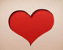 Heart cutout in paper. Red background inside. Royalty Free Stock Photos