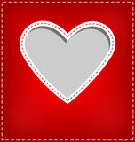 Heart cutout in red card on grey Stock Photos