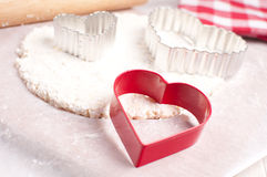 Heart cutter for cookies making Royalty Free Stock Photography
