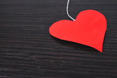 Heart on a dark background. Red heart on a dark wooden background Royalty Free Stock Image