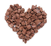 Heart of dark chocolate pieces. Heart of dark chocolate pieces, isolated on a white background Royalty Free Stock Photo