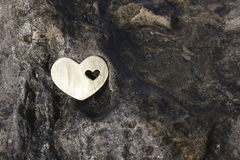 Heart on a Dark Wet Rock Royalty Free Stock Image