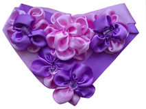Heart decorated with flowers from satiny ribbons. Heart decorated with flowers from satiny pink and violet ribbons Royalty Free Stock Photos