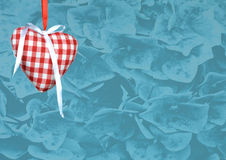 Heart decoration against flower texture background Stock Photos