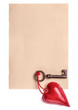 Heart decoration and key on empty paper sheet Royalty Free Stock Image
