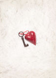 Heart decoration and old key on snow background Royalty Free Stock Photos