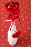 Heart decorations in a vase Stock Images