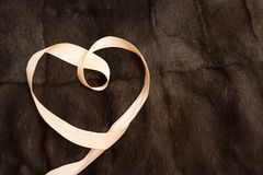 Heart with decorative ribbon. Stock Images