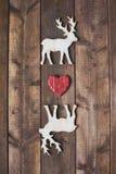 Heart between deers Royalty Free Stock Photos