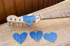 Heart of denim on the guitar. Happy friendship day Royalty Free Stock Images